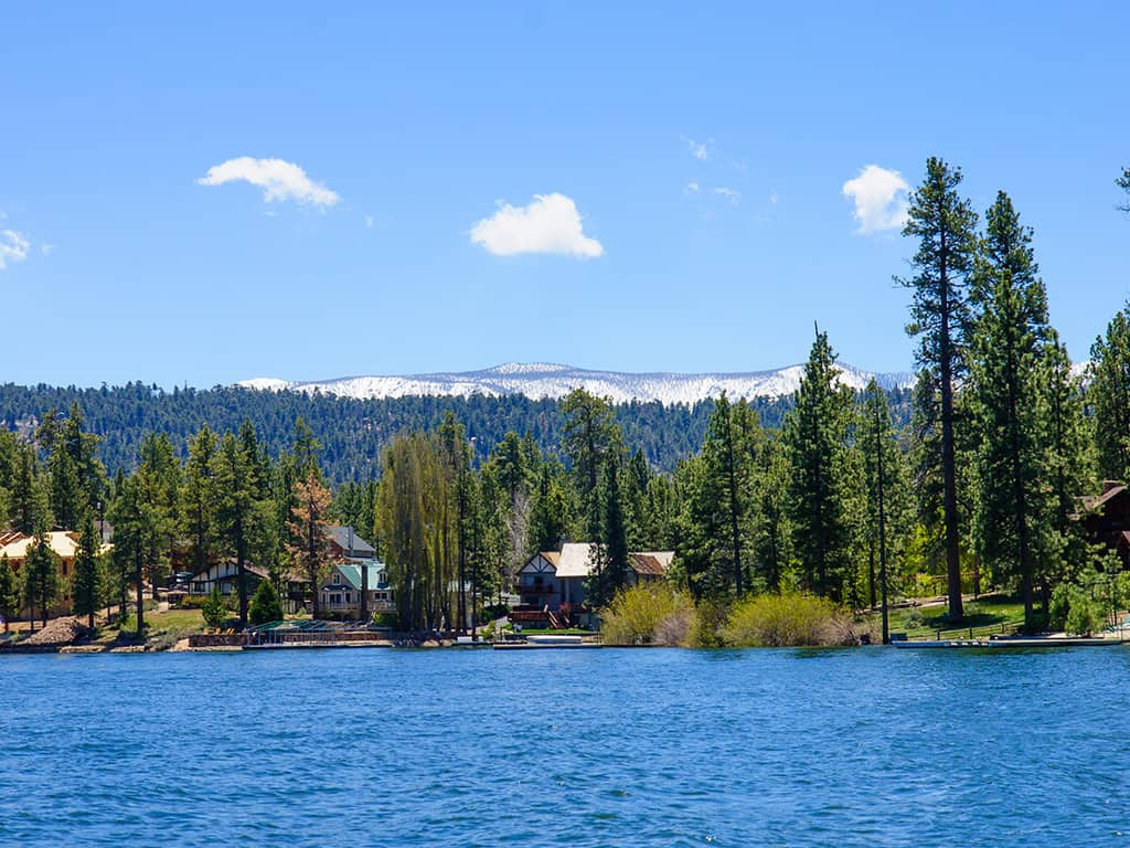 cabin on Big Bear Lake with snow-capped mountains