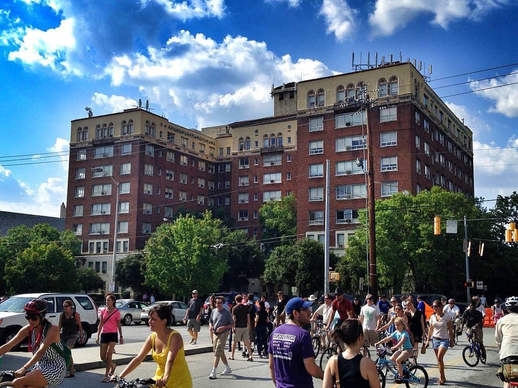 people walking past the Briarcliff Hotel in Atlanta, Georgia