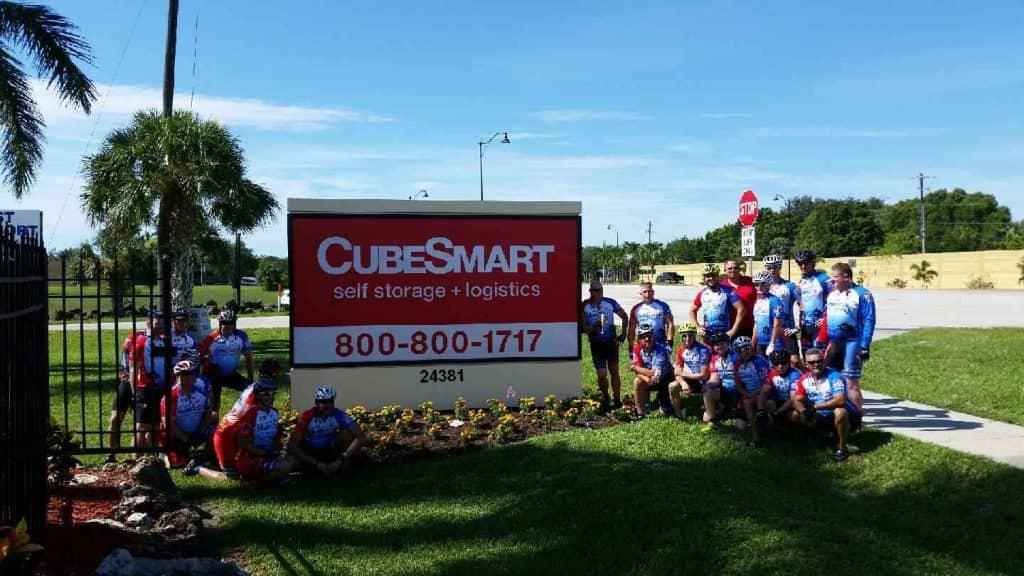 CubeSmart-Bonita-Springs-Self-Storage-Brotherhood-Ride-bicyclists-by-sign