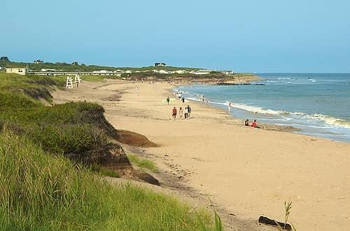 people walking on the beach in Montauk, NY