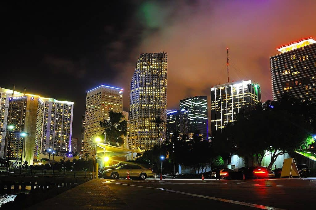downtown miami at night with buildings lit up