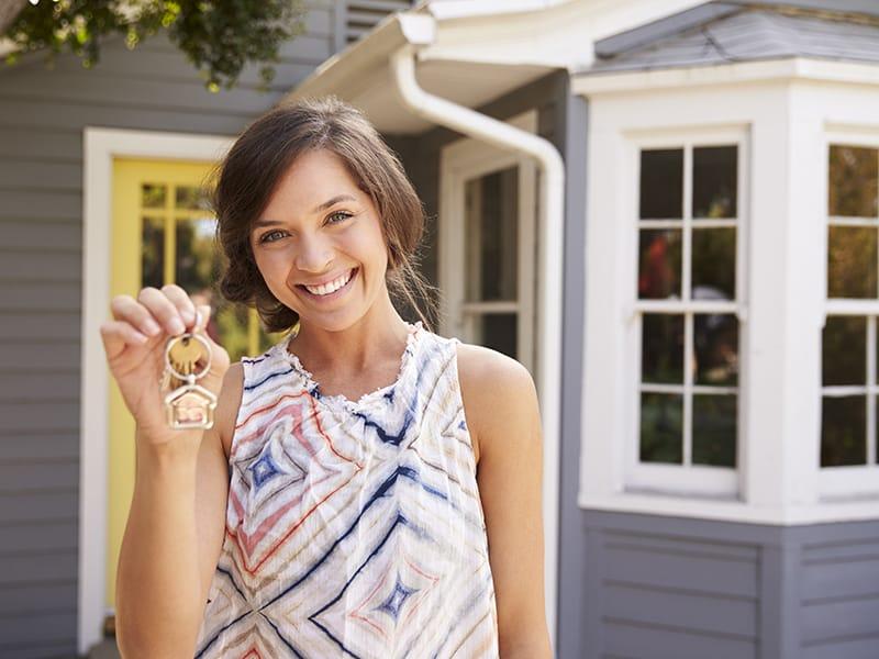 woman holding house keys