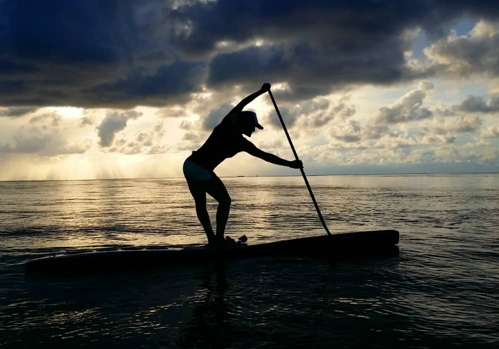 A paddle boarder at sunrise in Biscayne Bay, Florida