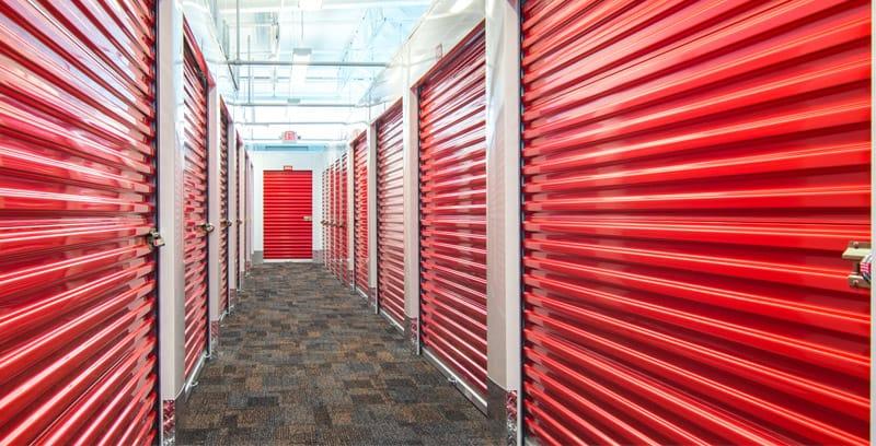 hallway of red storage doors