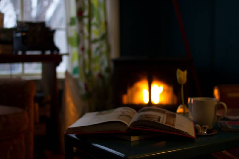 hygge open book in front of fireplace