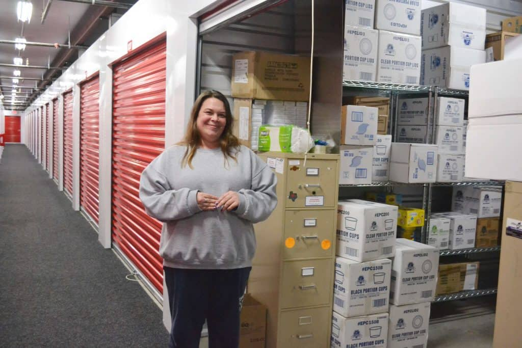 Candice Garcia standing in front of her storage unit