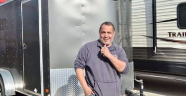 Desi Maes standing in front of his trailer at CubeSmart
