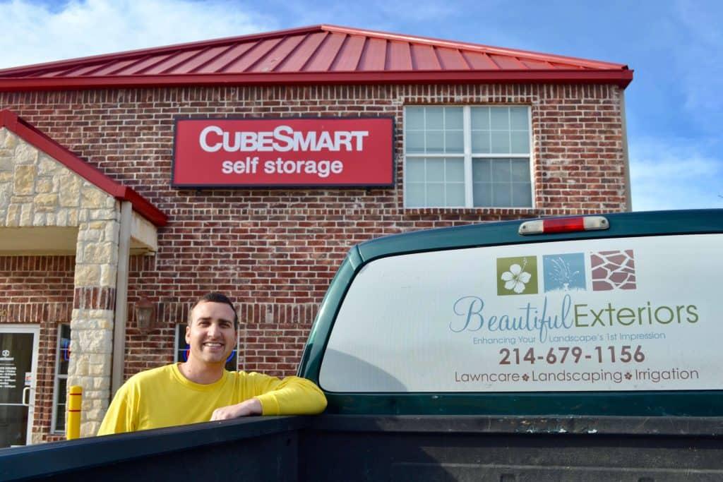 Kurt Patterson standing next to his work truck outside CubeSmart