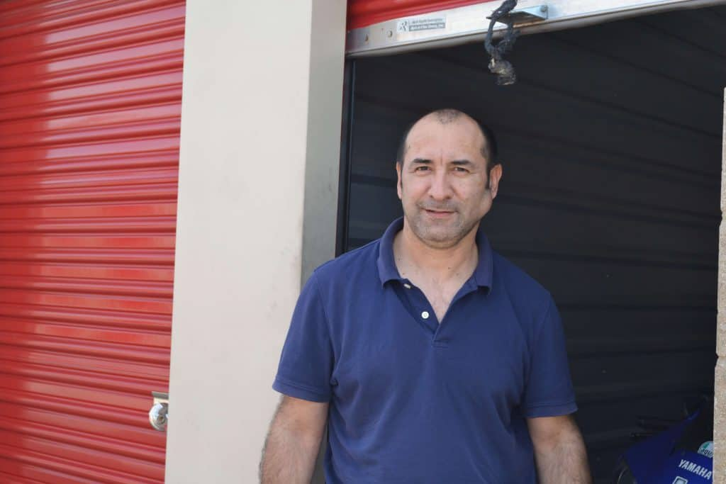 Tomas R. outside of his CubeSmart storage unit