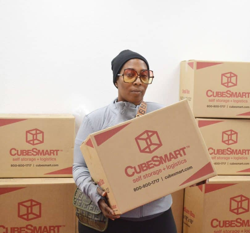 Traci M. holding CubeSmart boxes