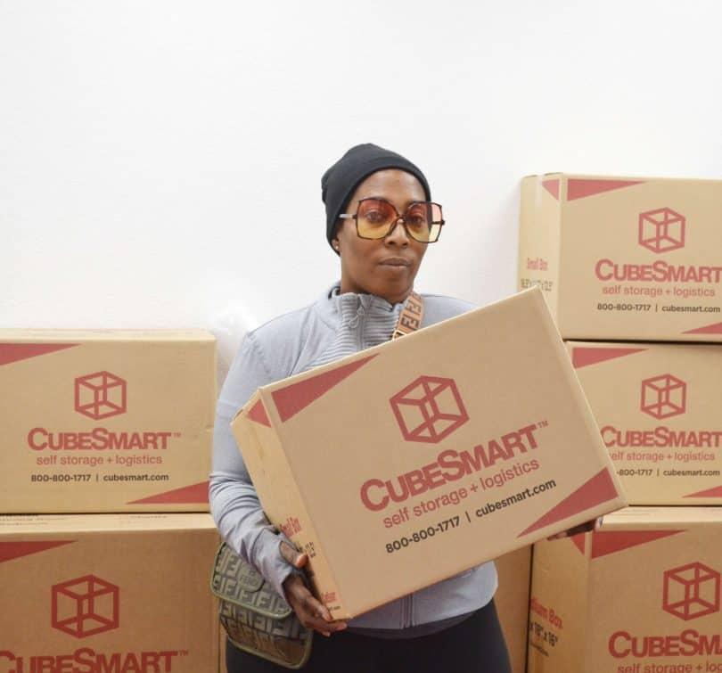 Traci M. holding CubeSmart boxes