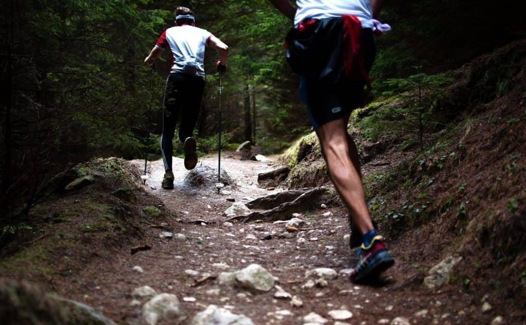 Two men running as an outdoor activity