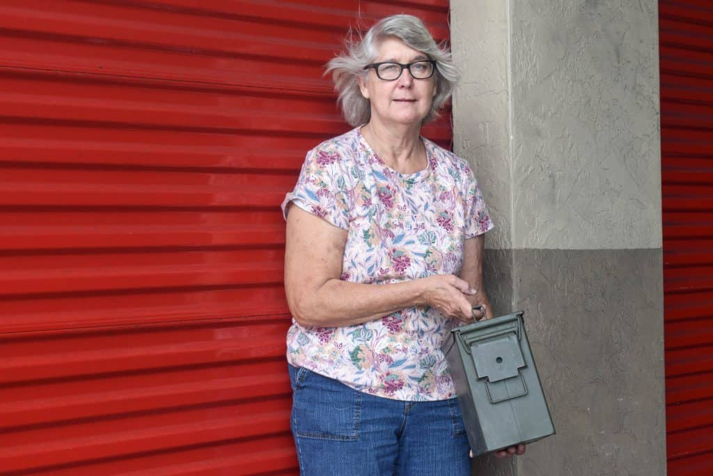Pauline Tal standing in front of her storage unit