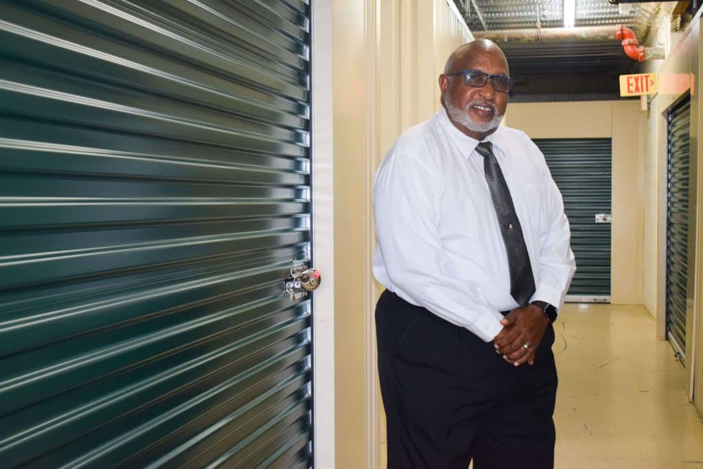Ron Carter standing next to his storage unit