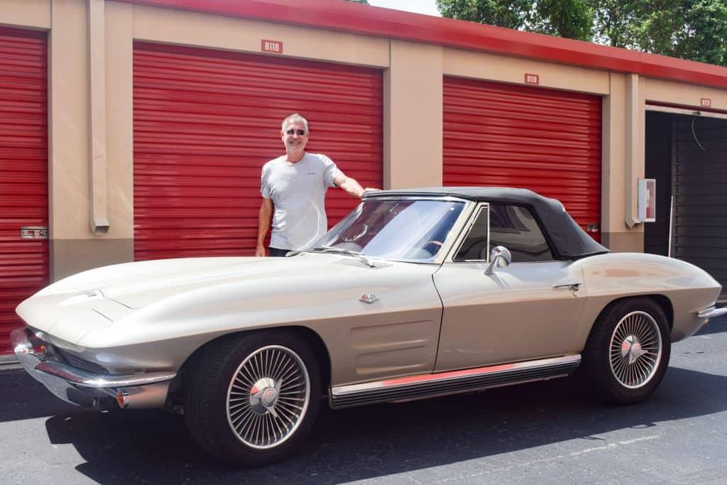 Scott Sheridan standing next to his 1964 Corvette