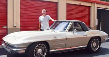 Scott Sheridan standing next to his 1964 Corvette