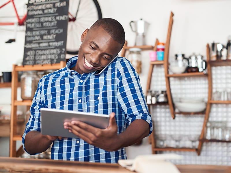black man on computer in retail shop