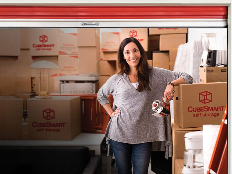 woman in packed storage unit
