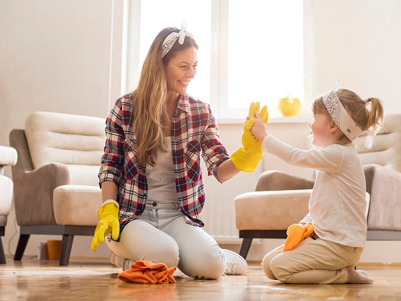 mom and daughter cleaning floor