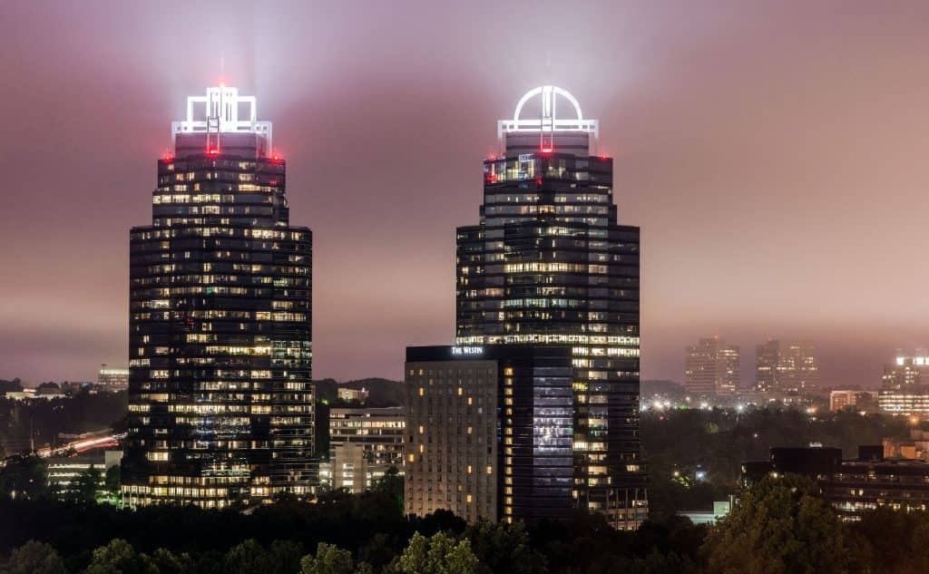 The King and Queen buildings in Atlanta lit up at night