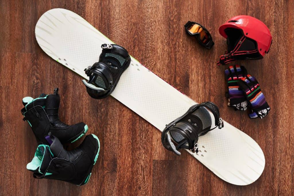 snowboard gear on a wooden floor