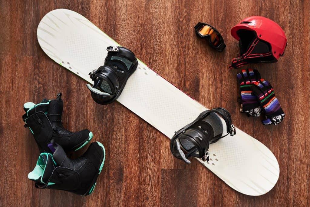 snowboard gear on a wooden floor