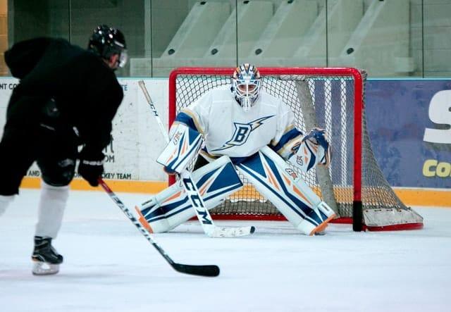 hockey goalie defending the goal