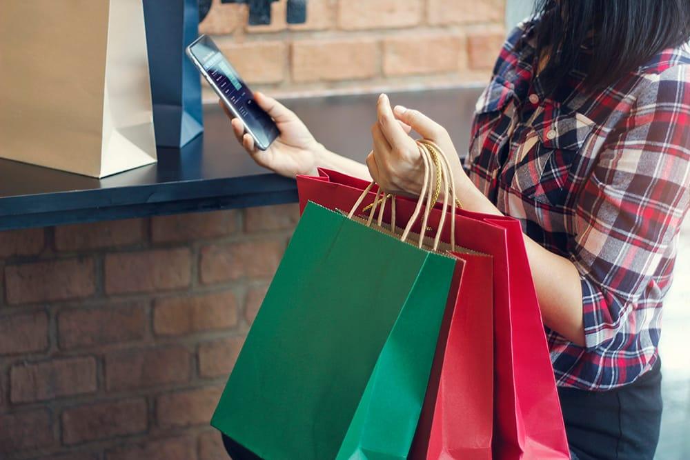 woman using christmas shopping app