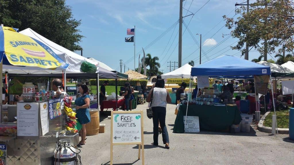 people shopping at a farmers market in Tamarac, Florida