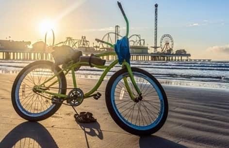 bike on Galveston Beach at sunset