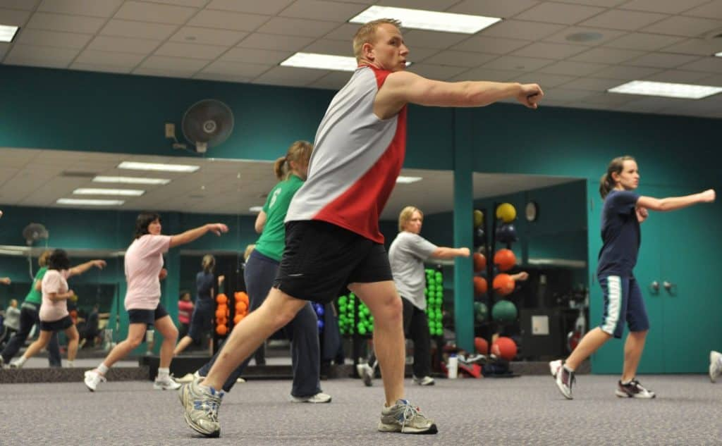 man leading a group in a fitness class