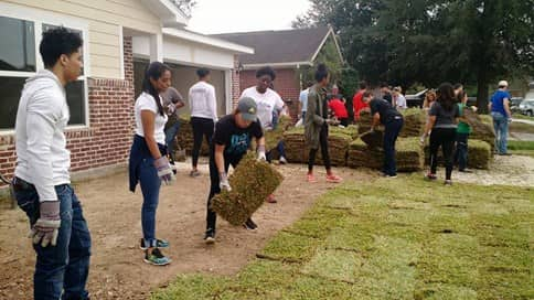 group of volunteers helping with Habitat for Humanity in Houston