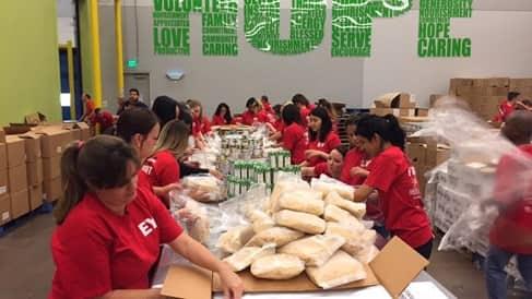 volunteers helping pack food at the Houston Food Bank