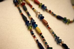 A pile of multicolored love bead bracelets