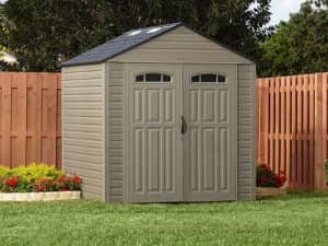 gray shed in a backyard