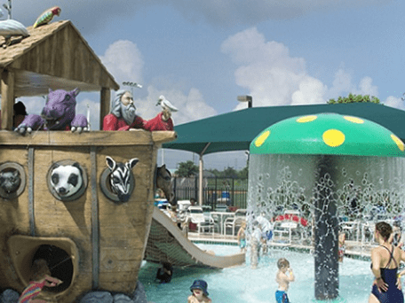 Children playing at Noah's Arc pool playground area in Houston, Texas