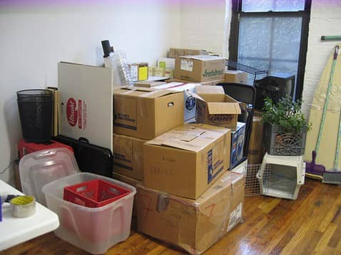 NYC living room filled with packed boxes