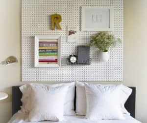 items hanging on a pegboard headboard