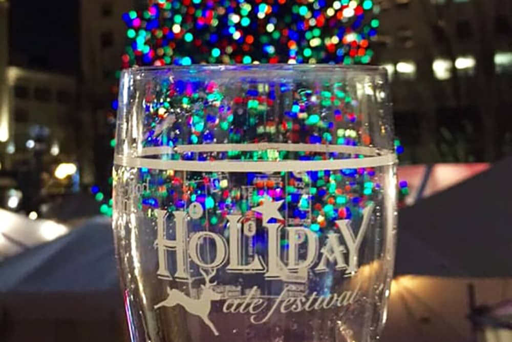 pint glass in front of christmas tree at holiday ale fest