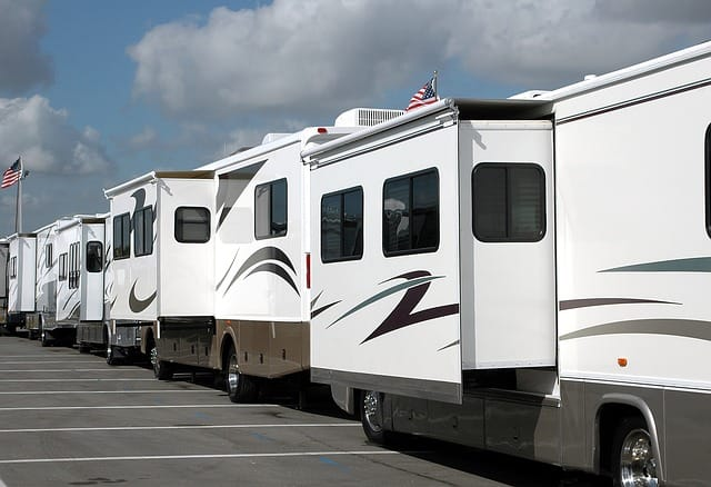 RVs lined up in parking lot