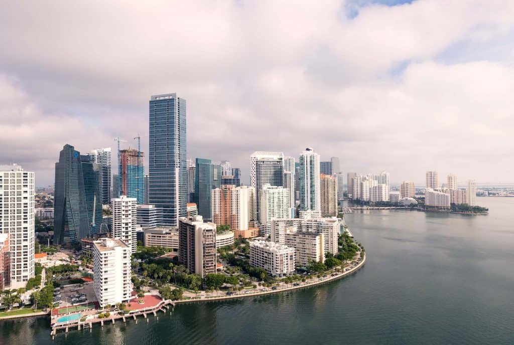 view of the Miami skyline and the water from the side