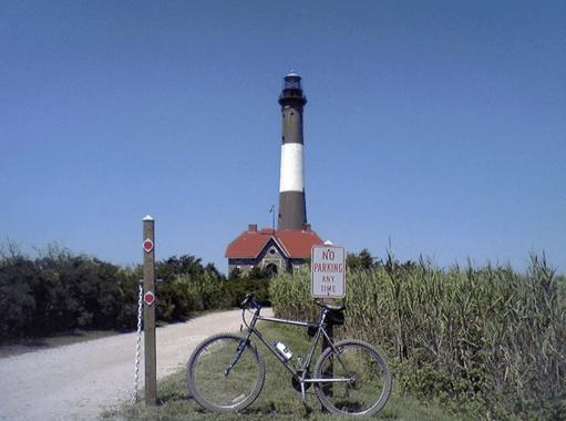 a bike parked outside of a lighthouse