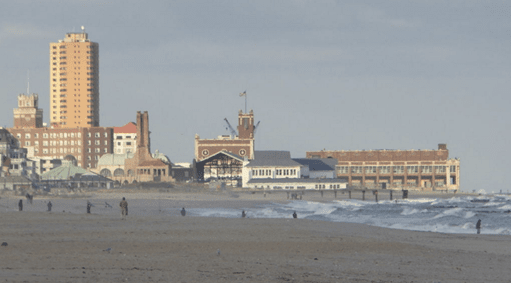 view of the boardwalk and beach at Asbury Park