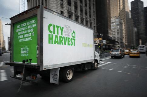 City Harvest truck driving through New York City