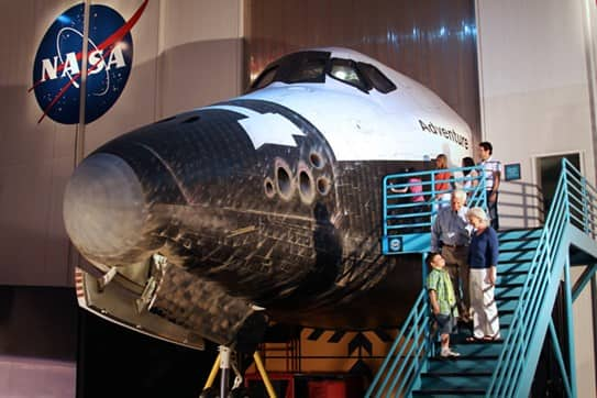 people visiting a replica of a space craft at NASA in Houston