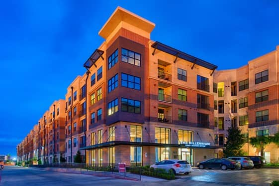 exterior shot at night of The Millennium Kirby apartments in Houston