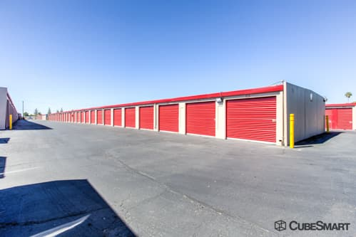 Self storage units with red roll-up doors in North Highlands, CA