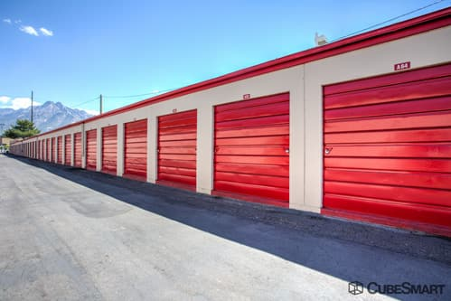 Self storage units with red roll-up doors in Murray, UT
