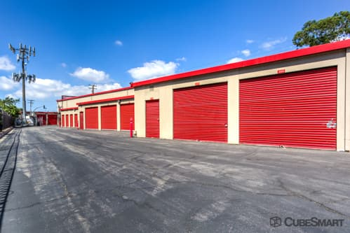 Self storage units with red roll-up doors in Long Beach, CA