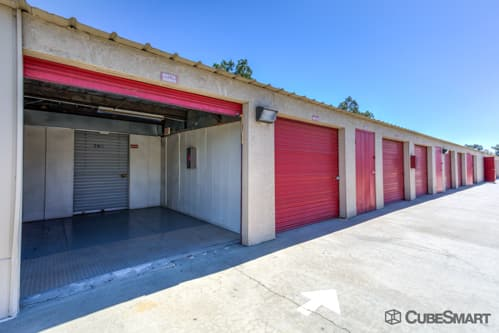 Self storage units with red roll-up doors in Riverside, CA